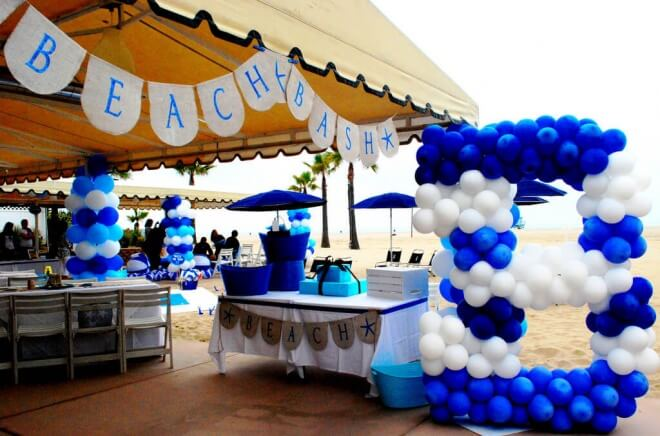 A boy 39 s beach bash first birthday party spaceships and for Balloon decoration for birthday boy