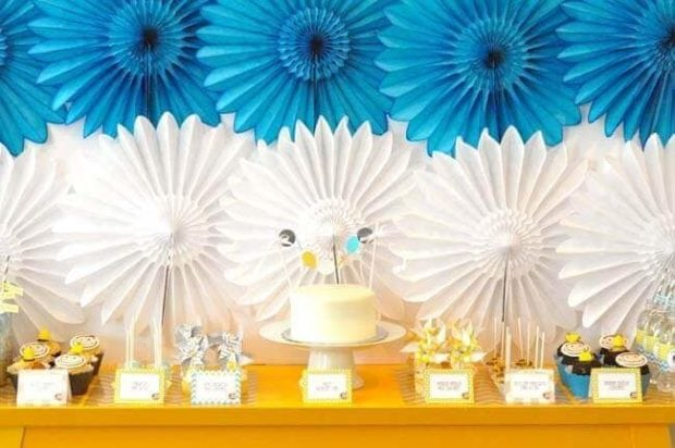 The dessert table at this Curious George birthday party featured bright colors and modern details as well as incredible treats