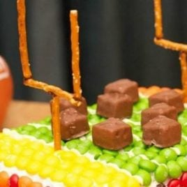 A plate of food with a birthday cake, with Party