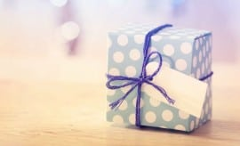 Polka dot present box with label in a bright room