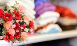 Close-up of decorative flowers on a shelf