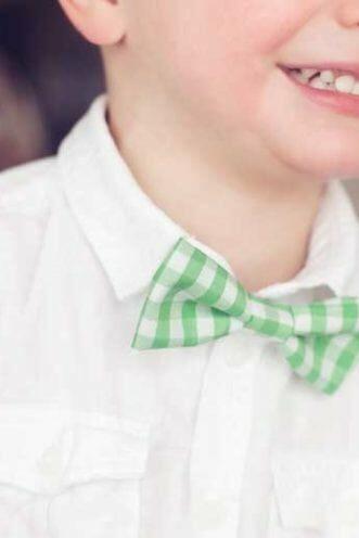 A smiling boy wearing a green shirt