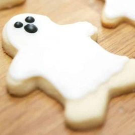 A wooden cutting board, with Cookie and Ghost
