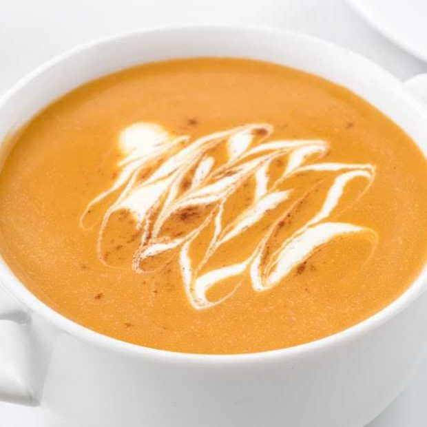 close up shot of a cup of butternut squash soup