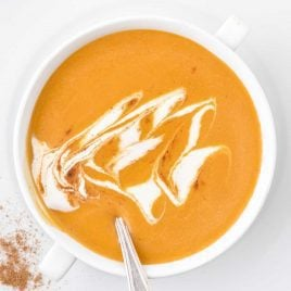 close up overhead shot of a cup of butternut squash soup