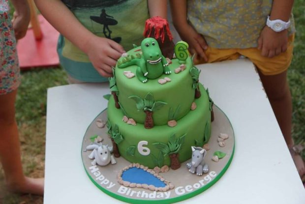 Did you spy the cake wow two tiers decorated with fondant dinosaurs
