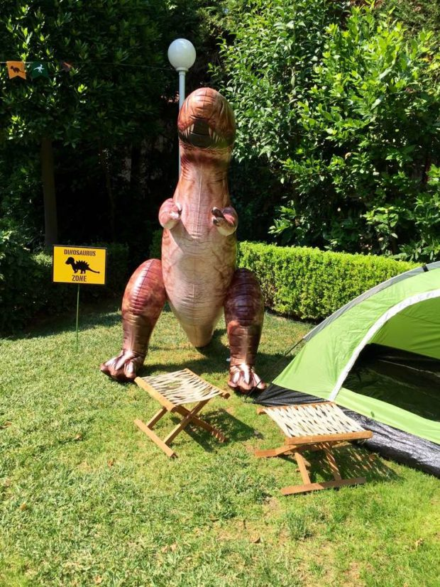 A wildly fun boy 39 s dinosaur party spaceships and laser beams for Backyard party decoration crossword