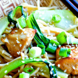 A close up of a plate of food, with Chicken and Chow mein