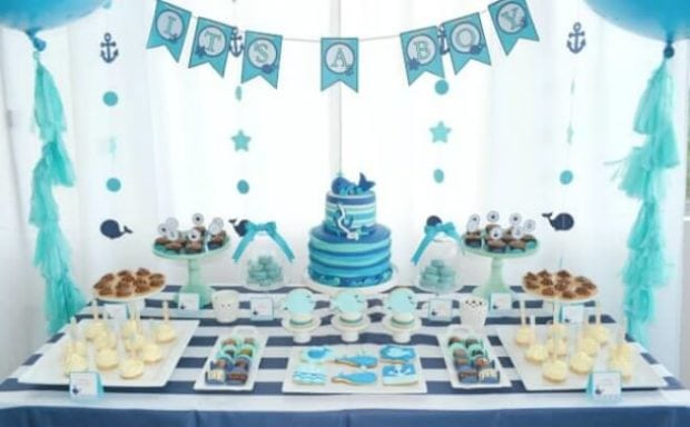 A boy 39 s whale themed baby shower spaceships and laser beams for Baby clothesline decoration baby shower