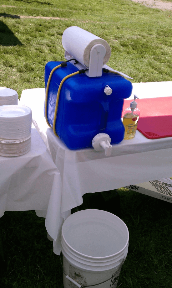 Keep hands clean while camping using this simple DIY hand washing station.