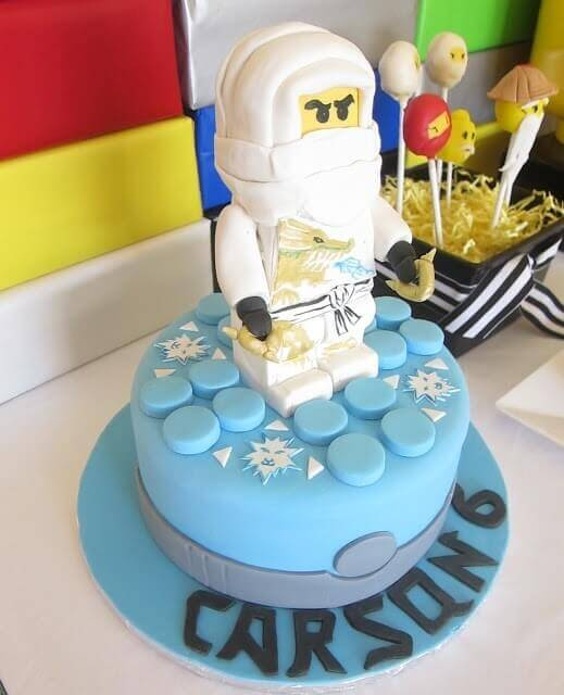 This amazing Lego Ninjago cake features a giant Lego character atop a delicious cake.