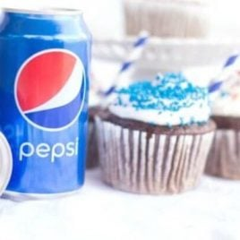 A glass with a blue cup, with Cupcake