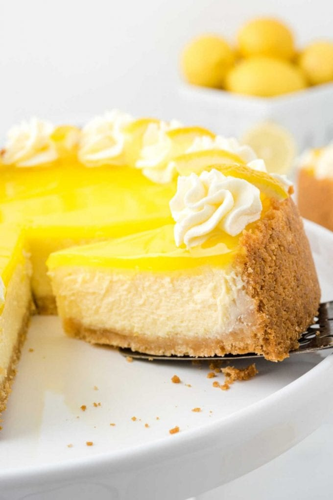 lemon cheesecake with a slice being removed with a spatula