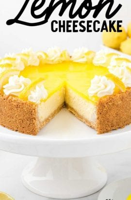 lemon cheesecake on a cake serving tray with a slice missing