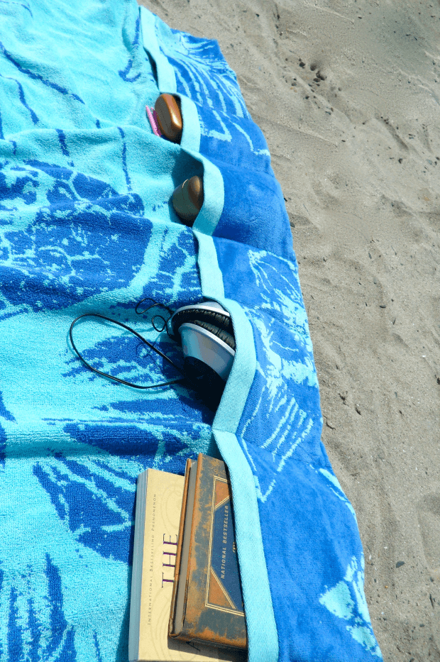 This DIY beach hack results in Pocketed Beach Towels to keep things organized while you relax.