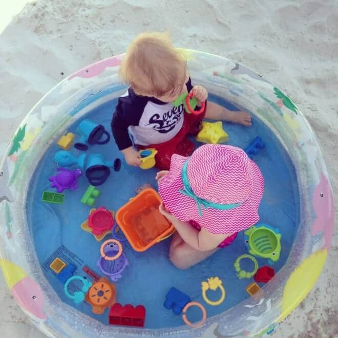 Let kids safely enjoy the water in their own beach pool. The ultimate mom beach hack.