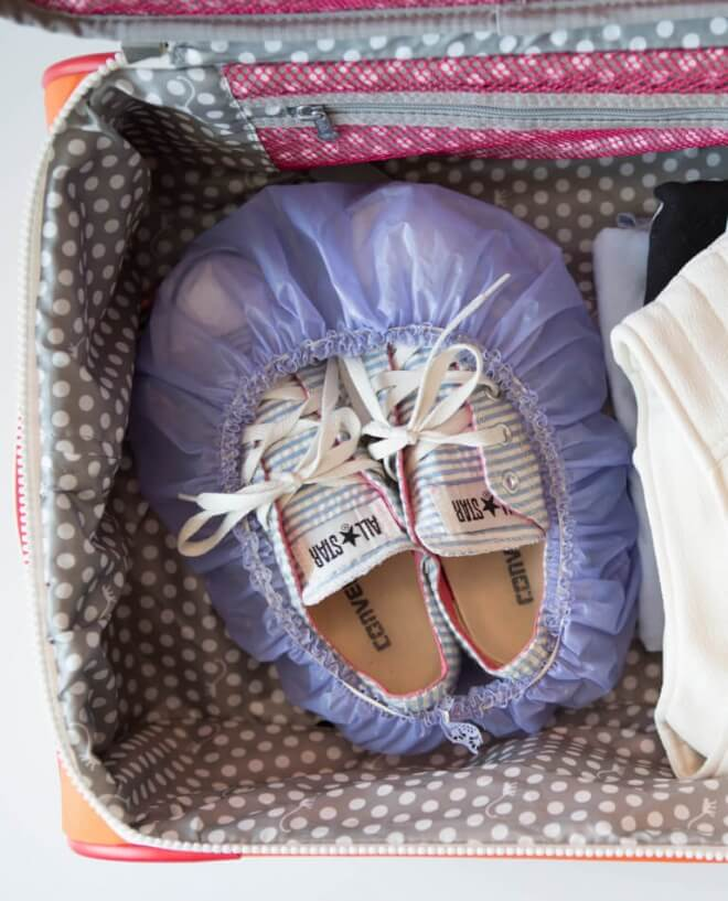 Use a shower cap to keep shoes from dirtying clothes in your suitcase.