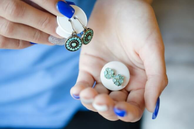 Use buttons to keep sets of earrings together while travelling.