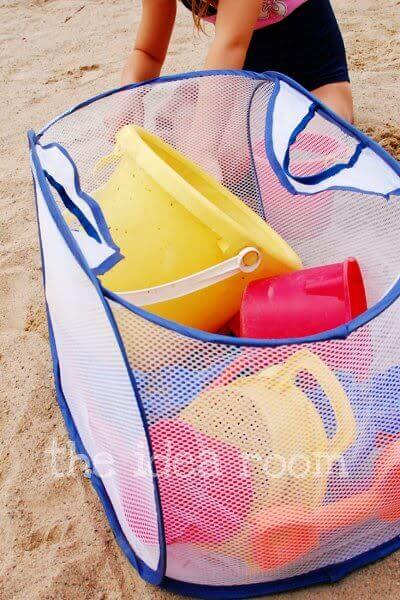 Use a mesh bag to store toys, to make sure the toys come home, but leave the sand by the ocean.