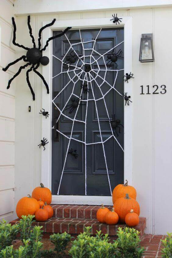 halloween witch door decorating ideas door hanger spiderweb halloween door decorations 19 decorating ideas that are hauntingly awesome