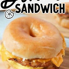 close up shot of a donut sandwich on a wooden board