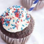 A close up of a piece of cake on a plate, with Cupcake and Pepsi