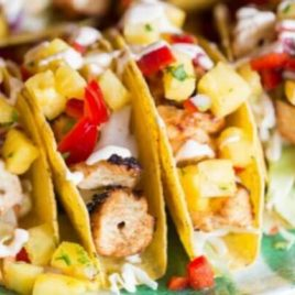 A dish is filled with food, with Shrimp and Taco