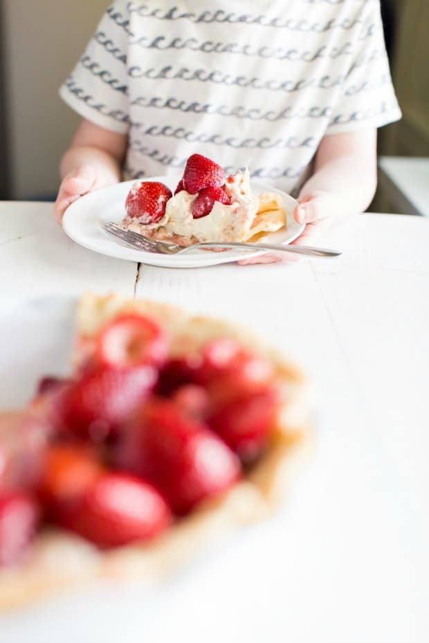 boy eating strawberry pie