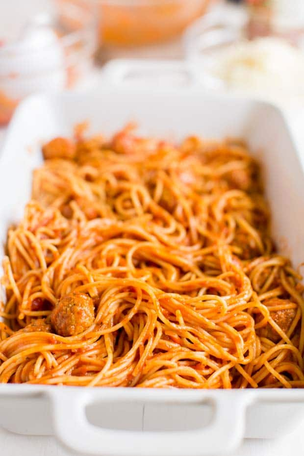 baked spaghetti and meatballs in a casserole dish