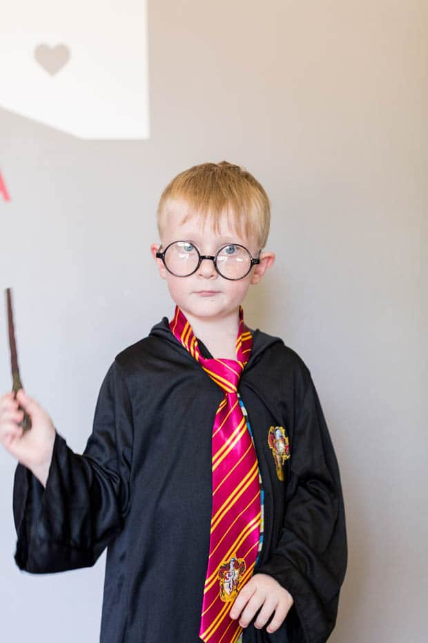 A person posing for the camera, with Harry Potter