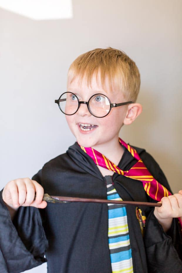 A boy wearing glasses, with Harry Potter and Butterbeer