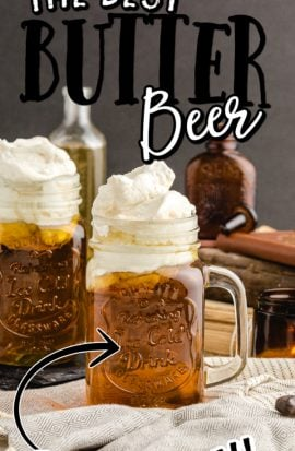 butterbeer in a glass mug with whipping on top