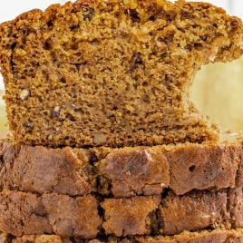 close up shot of slices of Pumpkin Banana Bread stacked on top of each other