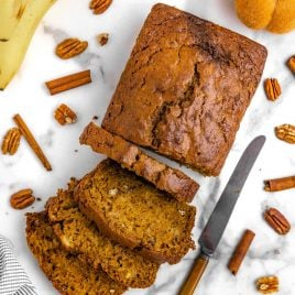 close up overhead shot of a loaf of Pumpkin Banana Bread with slices cut out