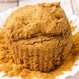 close up shot of 2-ingredient Pumpkin Spice Muffins with the muffin wrapper peeled
