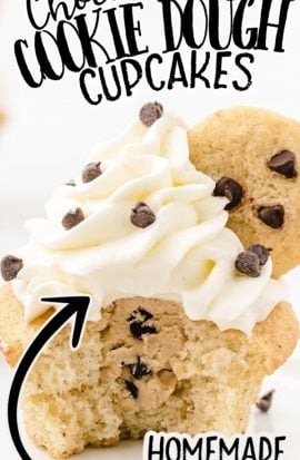 close up shot of cookie dough cupcakes topped with whipped cream frosting and a mini chocolate chip cookie with a bite taken out of it