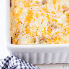 close up shot of biscuits and gravy breakfast casserole in a white baking pan