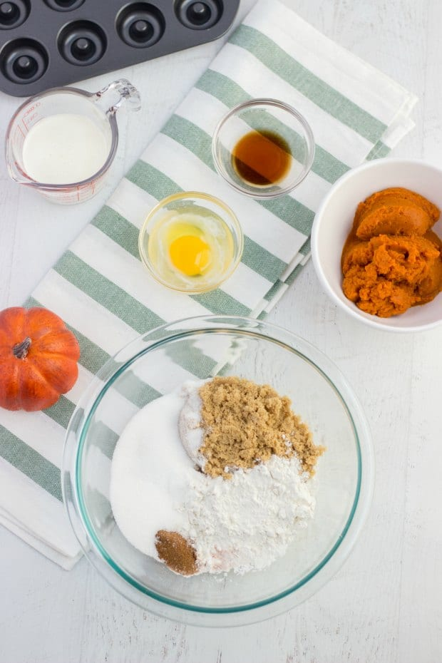 overhead of ingredients for baked pumpkin donuts