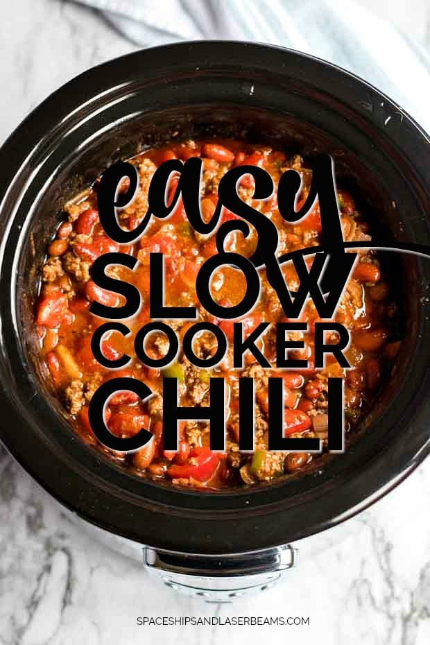slow cooker with chili in it overhead shot