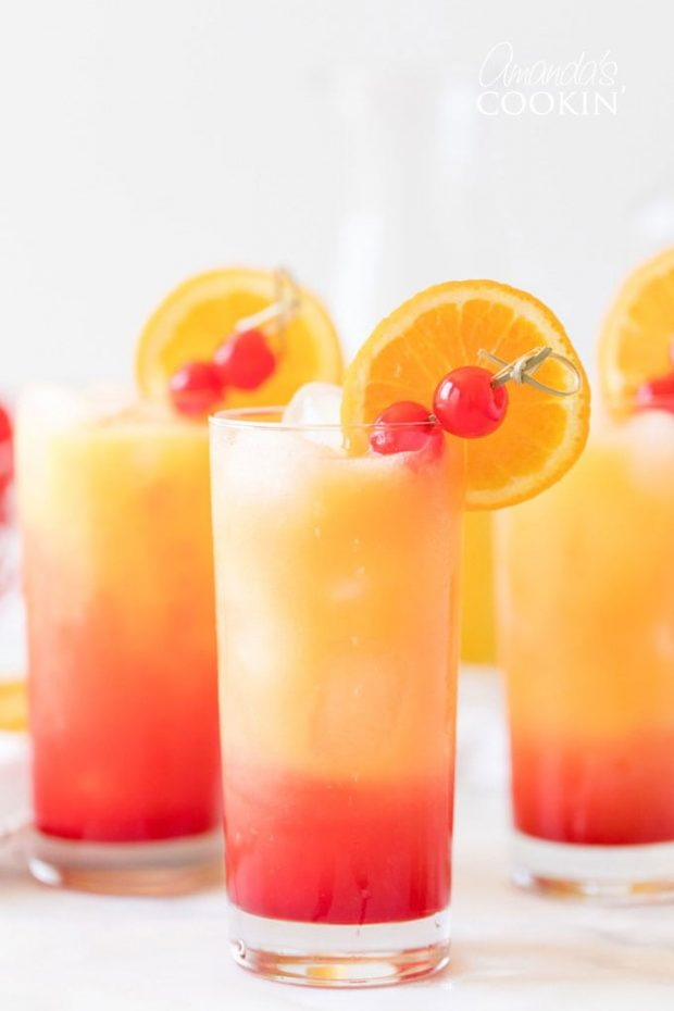 A glass of orange juice, with Tequila sunrise