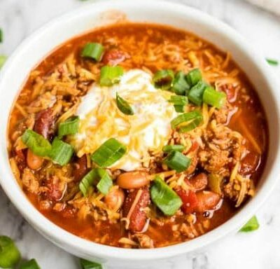 bowl of turkey chili with sour cream on top