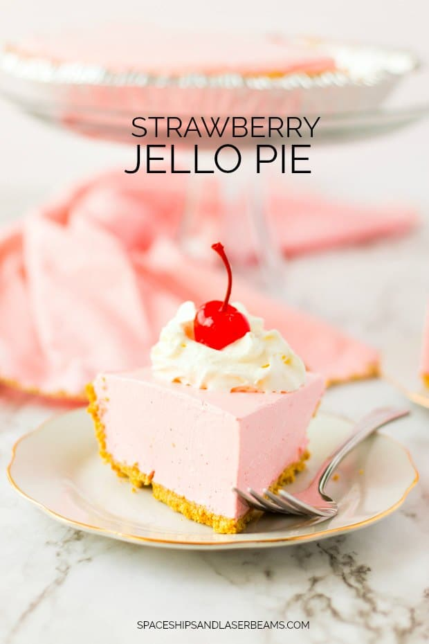 Slice of Strawberry Jello Pie with Whipped Cream and Cherry on Top