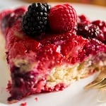 A close up of a piece of cake on a plate, with Berry