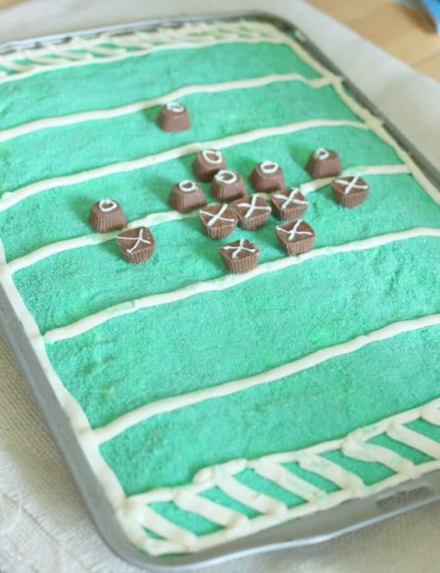 sheet cake decorated like a football field