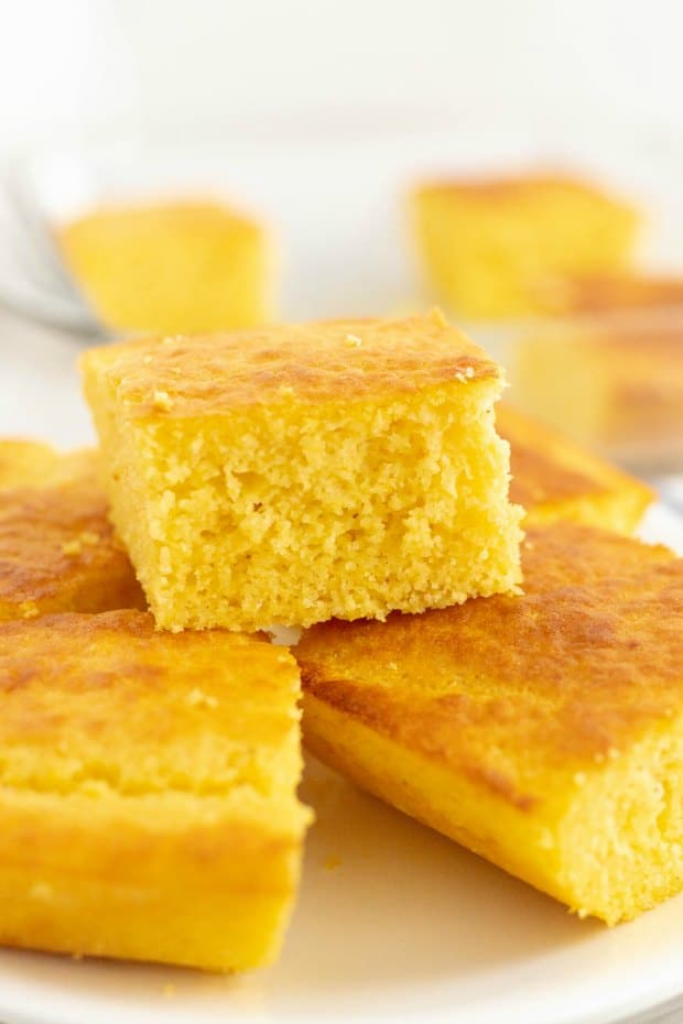 A piece of cake on a plate, with Cornbread
