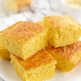 A piece of cake on a plate, with Cornbread and Laser