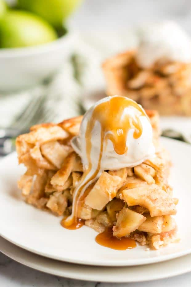 slice of apple pie with ice cream and caramel on top