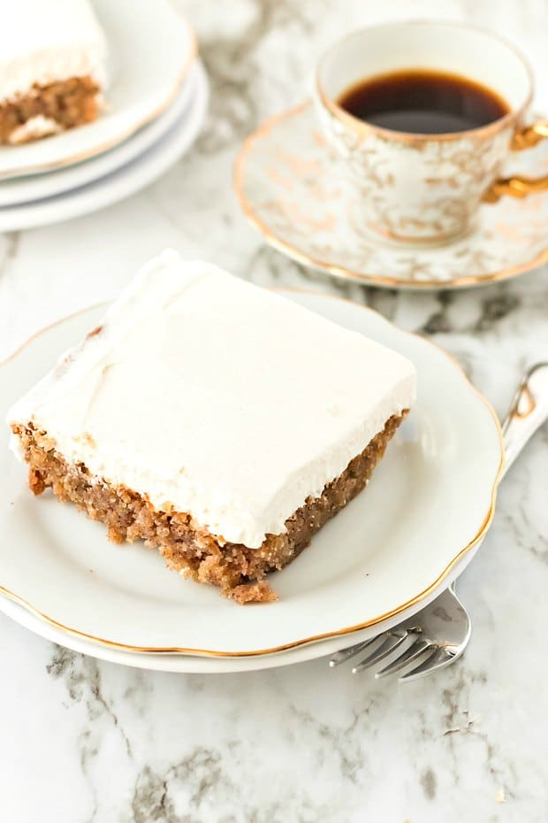 square slice of oatmeal cake with white frosting