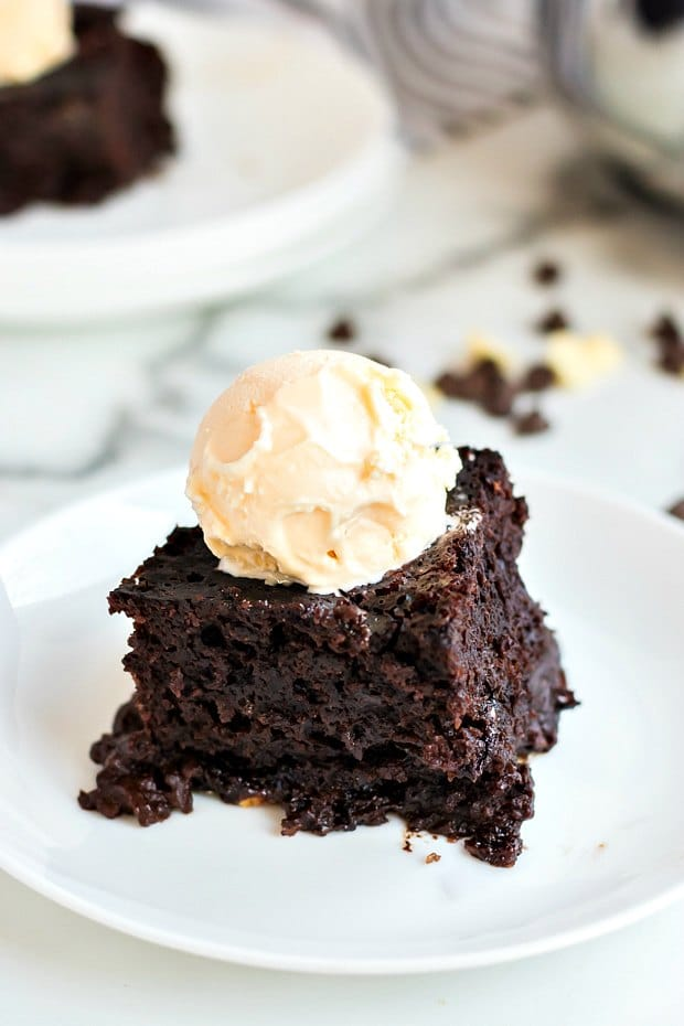 piece of chocolate cake with vanilla ice cream on top