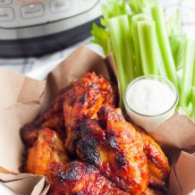Chicken wings in a basket in front of an Instant Pot